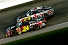 Jeff Gordon, driver of the #24 Axalta Coatings Chevrolet, races Kevin Harvick, driver of the #4 Jimmy John's Chevrolet, during the NASCAR Sprint Cup Series 5-Hour Energy 400 at Kansas Speedway on May 10, 2014 in Kansas City, Kansas. - Photo Credit: Kyle Rivas/Getty Images