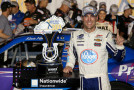 Kevin Harvick, driver of the #5 Kroger/P&G Chevrolet, celebrates with the trophy after winnining the NASCAR Nationwide Series John R. Elliott HERO Campaign 300 at Kentucky Speedway on June 27, 2014 in Sparta, Kentucky. - Photo Credit: Todd Warshaw/Getty Images