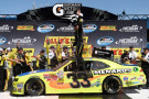 Paul Menard, driver of the #33 Nibco/Menards Chevrolet, celebrates in Victory Lane after winning the NASCAR Nationwide Series Ollie's Bargain Outlet 250 at Michigan International Speedway on June 14, 2014 in Brooklyn, Michigan. - Photo Credit: Jason Miller/Getty Images