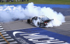Jimmie Johnson, driver of the #48 Lowe's/Kobalt Tools Chevrolet, celebrates with a burnout after winning the NASCAR Sprint Cup Series Quicken Loans 400 at Michigan International Speedway on June 15, 2014 in Brooklyn, Michigan. - Photo Credit: Jonathan Daniel/Getty Images