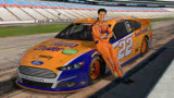 Joey Logano Poses with the No. 22 AutoTrader.com Ford Fusion at New Hampshire Motor Speedway