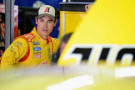 Joey Logano, driver of the #22 Shell-Pennzoil Ford, stands in the garage area during practice for the NASCAR Sprint Cup Series Oral-B USA 500 at Atlanta Motor Speedway in Hampton, Georgia. - Photo Credit: Jonathan Moore/Getty Images