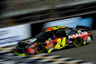 2014 NSCS Driver Jeff Gordon crosses the start/finish line at Michigan International Speedway in the No. 24 Axalta Chevrolet SS - Photo Credit: Jared C. Tilton/Getty Images