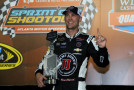 Kevin Harvick, driver of the #4 Jimmy John's Chevrolet, poses with the trophy after qualifying at the pole position for the NASCAR Sprint Cup Series Oral-B USA 500 at Atlanta Motor Speedway on August 29, 2014 in Hampton, Georgia. - Photo Credit: Mike Ehrmann/Getty Images