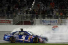 Kasey Kahne, driver of the #5 Farmers Insurance Chevrolet, celebrates with a burnout after winning the NASCAR Sprint Cup Series Oral-B USA 500 at Atlanta Motor Speedway on August 31, 2014 in Hampton, Georgia. - Photo Credit: Jonathan Moore/Getty Images