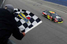 Jeff Gordon, driver of the #24 Axalta Chevrolet, takes the checkered flag to win the NASCAR Sprint Cup Series Pure Michigan 400 at Michigan International Speedway on August 17, 2014 in Brooklyn, Michigan. - Photo Credit: Brian Lawdermilk/Getty Images