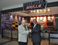 Talladega Superspeedway Chairman Grant Lynch stands in front of the Talladega Grille with Birmingham Mayor William A. Bell