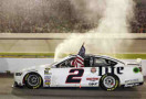 Brad Keselowski, driver of the #2 Miller Lite Ford, celebrates after winning the NASCAR Sprint Cup Series Federated Auto Parts 400 at Richmond International Raceway on September 6, 2014 in Richmond, Virginia. - Photo Credit: Brian Lawdermilk/Getty Images