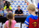 NASCAR Chase Driver AJ Allmendinger talks with young fans while making a Chase Across North America appearance on behalf of Kansas Speedway at a Hy-Vee grocery store on September 10, 2014 in Shawnee, Kansas. - Photo Credit; Jamie Squire/Getty Images
