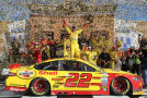 Joey Logano, driver of the #22 Shell-Pennzoil Ford, celebrates in Victory Lane after winning the NASCAR Sprint Cup Series Hollywood Casino 400 at Kansas Speedway on October 5, 2014 in Kansas City, Kansas. - Photo Credit: Jerry Markland/Getty Images