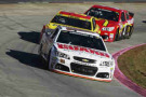 Dale Earnhardt Jr., driver of the #88 National Guard Chevrolet, leads a pack of cars during the NASCAR Sprint Cup Series Goody's Headache Relief Shot 500 at Martinsville Speedway on October 26, 2014 in Martinsville, Virginia. - Photo Credit: Brian Lawdermilk/Getty Images