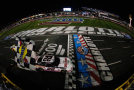 Brad Keselowski, driver of the #22 Discount Tire Ford, takes the checkered flag to win the NASCAR Nationwide Series Drive For The Cure 300 presented by Blue Cross Blue Shield of North Carolina at Charlotte Motor Speedway on October 10, 2014 in Charlotte, North Carolina. - Photo Credit: Chris Trotman/Getty Images