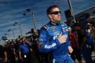 Carl Edwards, driver of the #99 Fastenal Ford, walks on the grid during pre-race ceremonies for the NASCAR Sprint Cup Series Ford EcoBoost 400 at Homestead-Miami Speedway on November 16, 2014 in Homestead, Florida. - Photo Credit: Patrick Smith/Getty Images