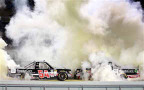 Darrell Wallace Jr., driver of the #54 ToyotaCare Toyota, and Kyle Busch, driver of the #51 ToyotaCare Toyota, burn out as Wallace celebrates winning the NASCAR Camping World Truck Series Ford EcoBoost 200 at Homestead-Miami Speedway and Kyle Busch wins the owner's championship on November 14, 2014 in Homestead, Florida. - Photo Credit: Chris Grayham/Getty Images