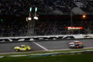 Matt Kenseth, driver of the #20 Dollar General Toyota, takes the checkered flag to win the 3rd Annual Sprint Unlimited at Daytona at Daytona International Speedway on February 14, 2015 in Daytona Beach, Florida. - Photo Credit: Chris Graythen/Getty Images