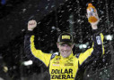 Matt Kenseth, driver of the #20 Dollar General Toyota, celebrates in victory lane after winning the 3rd Annual Sprint Unlimited at Daytona at Daytona International Speedway on February 14, 2015 in Daytona Beach, Florida. - Photo Credit: Jared C. Tilton/Getty Images