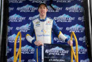 Brad Keselowski, driver of the #29 Cooper Standard Ford, poses with the Keystone Light Pole Award after qualifying for the pole position for the NASCAR Camping World Truck Series Hyundai Construction Equipment 200 at Atlanta Motor Speedway on February 28, 2015 in Hampton, Georgia. - Photo Credit: Sarah Glenn/Getty Images