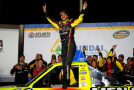 Matt Crafton, driver of the #88 Fisher Nuts/Menards Toyota, celebrates in victory lane after winning the NASCAR Camping World Truck Series Hyundai Construction Equipment 200 on February 28, 2015 in Hampton, Georgia. Photo Credit: Matt Sullivan/Getty Images