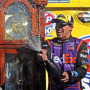 Denny Hamlin, driver of the #11 FedEx Express Toyota, celebrates in Victory Lane after winning the NASCAR Sprint Cup Series STP 500 at Martinsville Speedway on March 29, 2015 in Martinsville, Virginia. - Photo Credit: Rainier Ehrhardt/Getty Images