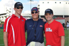"""University of Mississippi Head Football Coach Hugh Freeze (Center) will serve as the """"Honorary Pace Car Driver"""" for the GEICO 500 at Talladega Superspeedway on Sunday, May 3. Freeze, an avid NASCAR and Talladega Superspeedway fan, is pictured with his friend - NASCAR Driver Ricky Stenhouse Jr. (right) - sporting his Talladega hat during an Ole Miss Football practice last fall. Left of Freeze is Jason McCormick, a childhood friend of Stenhouse, Jr."""