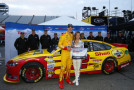 Joey Logano, driver of the #22 Shell-Pennzoil Ford, celebrates with Miss Coors Light Amanda Mertz after winning the Coors Light Pole Award for the NASCAR Sprint Cup Series Toyota Owners 400 at Richmond International Raceway on April 24, 2015 in Richmond, Virginia. - Photo Credit: Jared C. Tilton/Getty Images