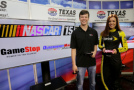 Erik Jones, driver of the #20 GameStop/Mortal Kombat X Toyota, left, and Miss Sprint Cup Madison Martin pose after playing the NASCAR 15 video game in the media center prior to qualifying for the NASCAR XFINITY Series O'Reilly Auto Parts 300 at Texas Motor Speedway on April 10, 2015 in Fort Worth, Texas. - Photo Credit: Jerry Markland/Getty Images