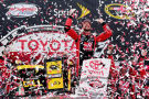 Kurt Busch, driver of the #41 Haas Automation Chevrolet, celebrates in Victory Lane after winning the NASCAR Sprint Cup Series Toyota Owners 400 at Richmond International Raceway on April 26, 2015 in Richmond, Virginia. - Photo Credit: Jared C. Tilton/Getty Images