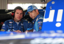 Elliott Sadler, driver of the #1 OneMain Financial Ford, talks to crew chief Phil Gould - Photo Credit: Brian Lawdermilk/Getty Images