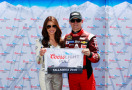 Jeff Gordon, driver of the #24 Drive To End Hunger Chevrolet, poses with Miss Coors Light Amanda Mertz and the Coors Light Pole Award after qualifying for pole position for the NASCAR Sprint Cup Series GEICO 500 at Talladega Superspeedway on May 2, 2015 in Talladega, Alabama. - Photo Credit: Brian Lawdermilk/Getty Images