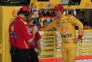 """Joey Logano, driver of the #22 Shell Pennzoil Ford, right, speaks with his crew in the garage area during practice for the NASCAR Sprint Cup Series Axalta """"We Paint Winners"""" 400 at Pocono Raceway on June 5, 2015 in Long Pond, Pennsylvania. - Photo Credit: Chris Trotman/Getty Images"""
