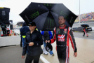 Kurt Busch, driver of the #41 Haas Automation Chevrolet, walks off the grid during a rain delay at the NASCAR Sprint Cup Series Quicken Loans 400 at Michigan International Speedway on June 14, 2015 in Brooklyn, Michigan. - Photo Credit: Chris Trotman/Getty Images