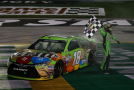 Kyle Busch, driver of the #18 M&M's Crispy Toyota, celebrates with the checkered flag after winning the NASCAR Sprint Cup Series Quaker State 400 presented by Advance Auto Parts at Kentucky Speedway on July 11, 2015 in Sparta, Kentucky. - Photo Credit: Todd Warshaw/Getty Images