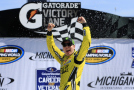 Kyle Busch, driver of the #51 Dollar General Toyota, celebrates in victory lane after winning the NASCAR Camping World Truck Series Careers for Veterans 200 at Michigan International Speedway on August 15, 2015 in Brooklyn, Michigan. - Photo Credit: Chris Trotman/Getty Images