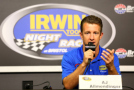 AJ Allmendinger, driver of the #47 Bush's Grillin Beans Chevrolet, speaks to the media during a press conference prior to practice for the NASCAR Sprint Cup Series Irwin Tools Night Race at Bristol Motor Speedway on August 21, 2015 in Bristol, Tennessee. - Photo Credit: Daniel Shirey/Getty Images