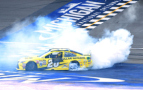 Matt Kenseth, driver of the #20 Dollar General Toyota, celebrates with a burnout after winning the NASCAR Sprint Cup Series Pure Michigan 400 at Michigan International Speedway on August 16, 2015 in Brooklyn, Michigan. - Photo Credit: Josh Hedges/Getty Images