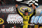Matt Kenseth, driver of the #20 Dollar General Toyota, celebrates in victory lane after winning the NASCAR Sprint Cup Series Pure Michigan 400 at Michigan International Speedway on August 16, 2015 in Brooklyn, Michigan. - Photo Credit: Sarah Crabill/Getty Images