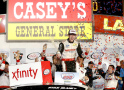 Ryan Blaney, driver of the #22 Discount Tire Ford, celebrates in victory lane after winning the NASCAR XFINITY Series U.S. Cellular 250 at Iowa Speedway on August 1, 2015 in Newton, Iowa. - Photo Credit: Brian Lawdermilk/Getty Images