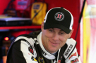 Kevin Harvick, driver of the #4 Jimmy John's / Budweiser Chevrolet, stands in the garage area during practice for the NASCAR Sprint Cup Series myAFibRisk.com 400 at Chicagoland Speedway on September 18, 2015 in Joliet, Illinois. - Photo Credit: Jonathan Daniel/Getty Images