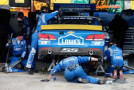 Crew members for Jimmie Johnson, driver of the #48 Lowe's Chevrolet, work to repair his car in the garagea during the NASCAR Sprint Cup Series AAA 400 at Dover International Speedway on October 4, 2015 in Dover, Delaware. - Photo Credit: Brian Lawdermilk/Getty Images