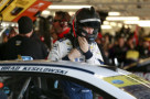 Brad Keselowski, driver of the #2 Miller Lite Ford, stands in the garage area during practice for the NASCAR Sprint Cup Series Hollywood Casino 400 at Kansas Speedway on October 16, 2015 in Kansas City, Kansas. - Photo Credit: Matt Sullivan/Getty Images